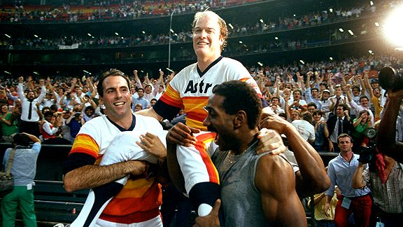 Teammates Jim Deshaies and Kevin Bass hoist Mike Scott into the air after he completes his division-clinching no-hitter, September 25, 1986